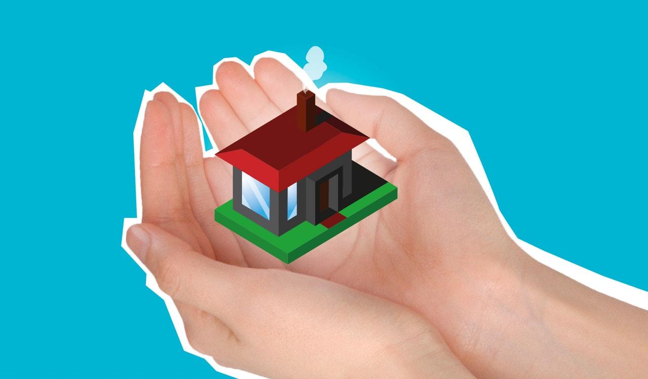 huis kwetsbaar beschermende handen